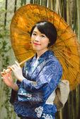 Japanese woman with umbrella — Stock Photo