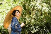 Japanese woman in the park — Stock Photo