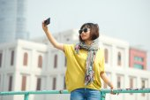 Stylish woman taking selfie — Stock Photo