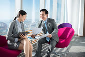 Business team discussing document — Stock Photo