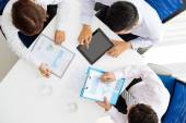 Business people  discussing charts and graphs — Stock Photo