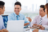 Cheerful manager at meeting — Stock Photo