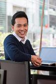Happy Vietnamese businessman — Stock Photo