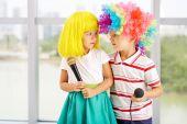 Children in colorful wigs — Stock Photo