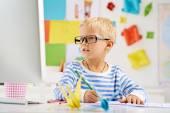 Little schoolboy in glasses — Stock Photo
