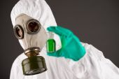 Man in respirator and protective clothing — Stock Photo