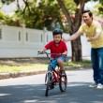 Son riding bike — Stock Photo #72200357