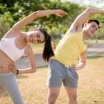 Doing back stretching exercise — Stock Photo #72200741