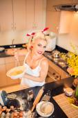Housewife cooking in kitchen — Stock Photo