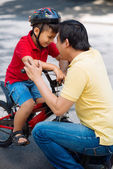 Man encouraging his son — Stock Photo