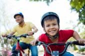 Boy riding bicycle — Stock Photo