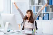 Female manager stretching — Stock Photo