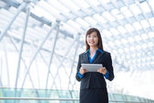 Business lady with digital tablet — Stock Photo
