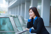 Smiling pensive business lady — Stock Photo