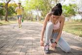 Woman checking shoelaces — Stock Photo