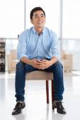 Man sitting on a chair — Stock Photo