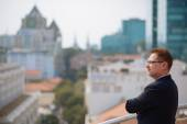 Confident businessman on rooftop — Stock Photo