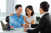 Shaking hands with real estate broker — Stock Photo