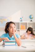 Girl daydreaming in class — Stock Photo