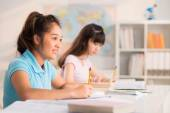 Schoolgirls Writing test — Stock Photo