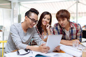 Students with digital tablet — Stock Photo
