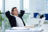 Businessman daydreaming in the office — Stock Photo