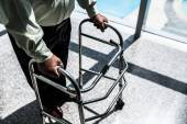 Man moving with walker — Stock Photo