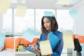 Businesswoman looking at adhesive notes — Stock Photo