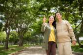 Senior couple walking in the park — Stock Photo
