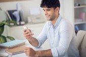 Man reading text message — Stock Photo
