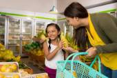 Little girl and her mother shopping — Stock Photo