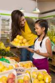 Mother and her daughter in the store — Stock Photo