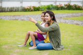 Mother and her daughter resting in the park — Stock Photo
