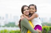 Indian woman carrying litter daughter — Stock Photo