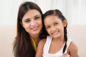 Smiling mother and daughter — Stock Photo