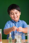 Schoolboy working with reagents — Stock Photo