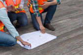 Engineers discussing plan of the building — Stock Photo