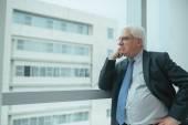 Pensive worried businessman — Stock Photo
