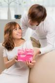 Man with  present for  girlfriend — Stock Photo