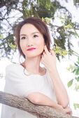 Smiling pensive woman — Stock Photo