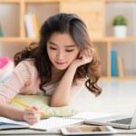 College student doing homework — Stock Photo #82479512