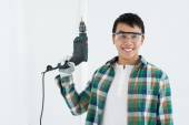 Asian an with a drill — Stock Photo