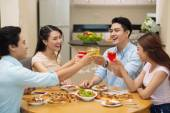 Friends clinking glasses at the dinner — Stock Photo