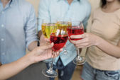 Friends clinking glasses at the party — Stock Photo