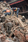KATHMANDU, NEPAL - APRIL 30, 2015: soldiers with debris of build — Stock Photo