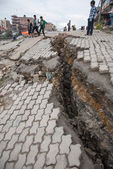 KATHMANDU, NEPAL - APRIL 30, 2015:  road damaged after the major — Stock Photo