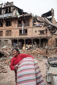 KATHMANDU, NEPAL - APRIL 30, 2015: People are seen among the deb — Stock Photo