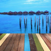 Wood table top on  seascape background montage concept — Stock Photo