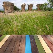 Wood table top on strange stone background montage concept — Stockfoto