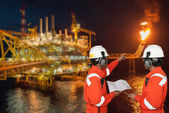 Oil worker and oil rig. montage concept — Stock Photo